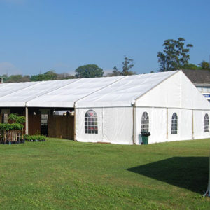 white frame tents with windows